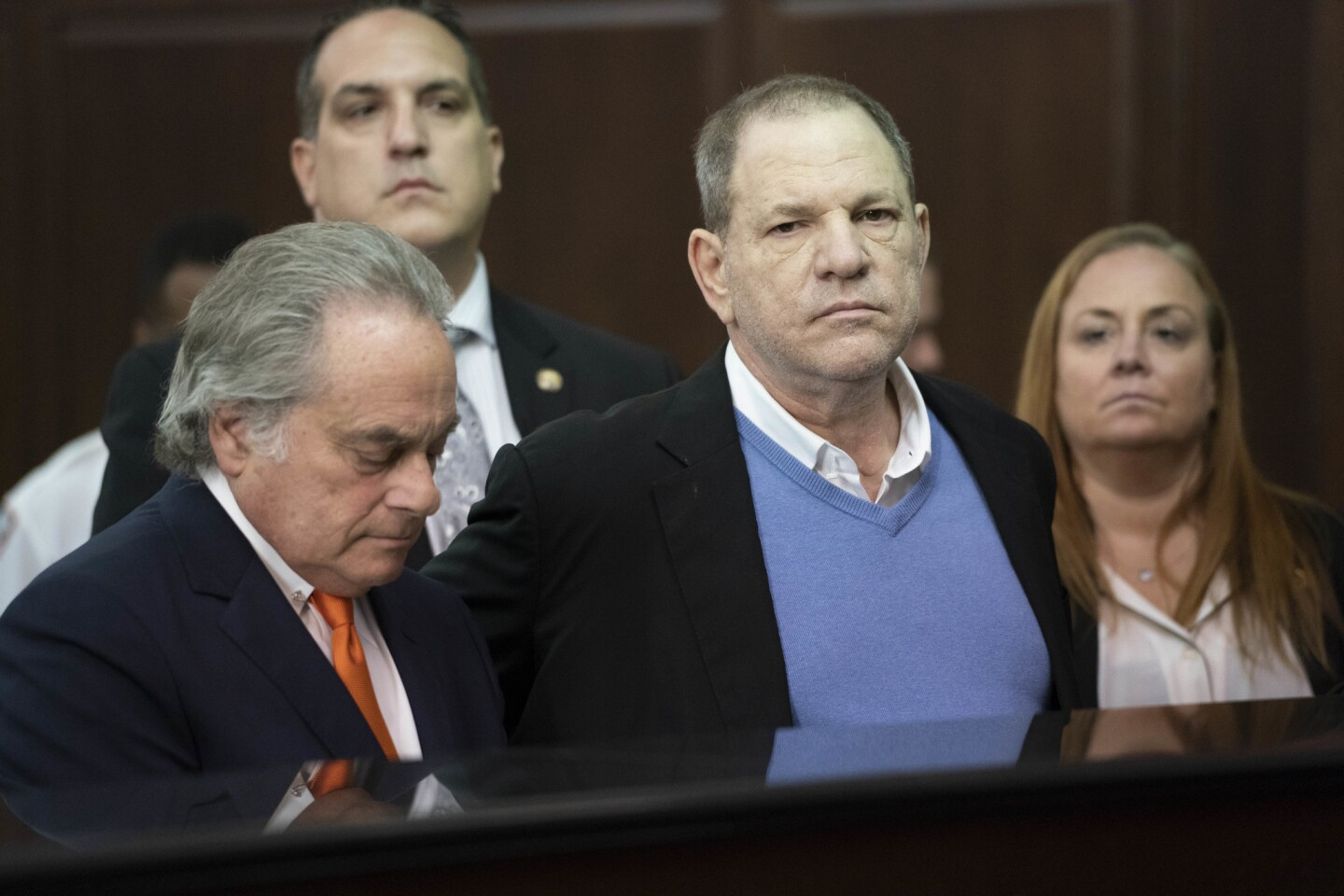 Harvey Weinstein, center, appears with his attorney Benjamin Brafman before a judge Friday morning in Manhattan, where he was charged with rape and other sex crimes.