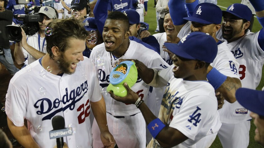 Clayton Kershaw, left, and his teammates celebrate with a bubble machine following his no-hitter against the Colorado Rockies in June. Major League Baseball has advised the Dodgers to stop using the machine during games.