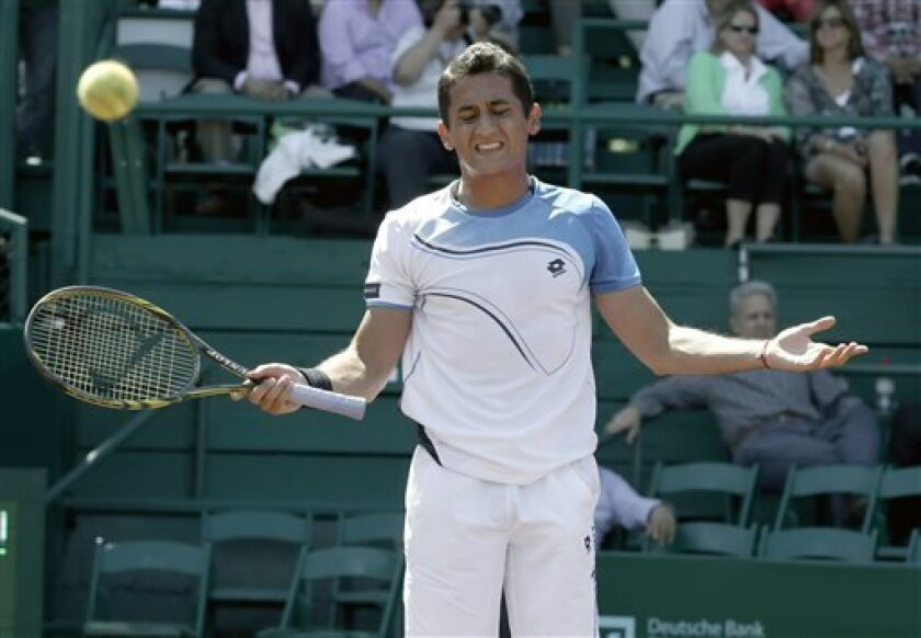 Nicolas Almagro, of Spain, reacts to losing a point against Paolo Lorenzi, of Italy, in their quarterfinal tennis match in the U.S. Men's Clay Court Championship, Friday, April 12, 2013, in Houston. (AP Photo/Pat Sullivan)