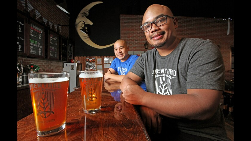 Brewyard co-owners Sherwin Antonio and Kirk Nishikawa with two of the beers currently available at the Brewyard, an Oktoberfest Rye Ale'd Lager and the Imposter Syndrome, an India Pale Ale'd Lager. Photographed on Thursday, October 20, 2016.