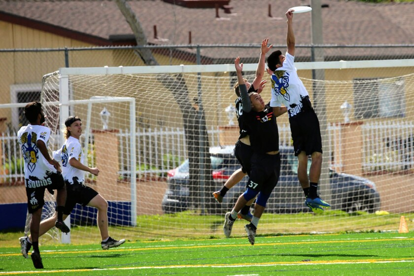 UCSD's Michael Huang makes a catch in a game of ultimate. Games are 7-on-7 with substitutions allowed.