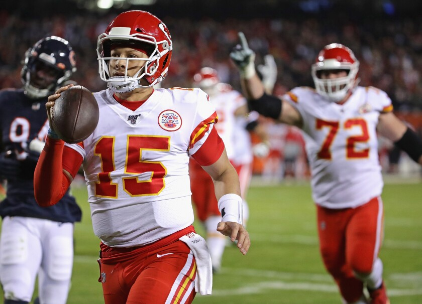 Chiefs quarterback Patrick Mahomes runs for a 12-yard touchdown in his team's 26-3 rout of the Bears on Dec. 22, 2019.