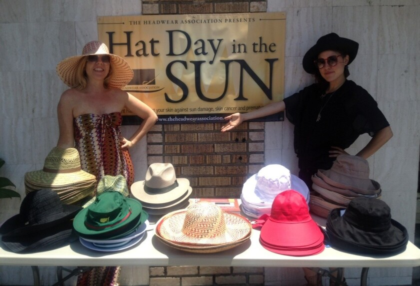A scene from the 2013 Hat Day in the Sun giveaway at the Eagle Rock Farmers Market. The Headwear Assn.'s public awareness campaign is set to give away thousands of hats nationwide June 19.