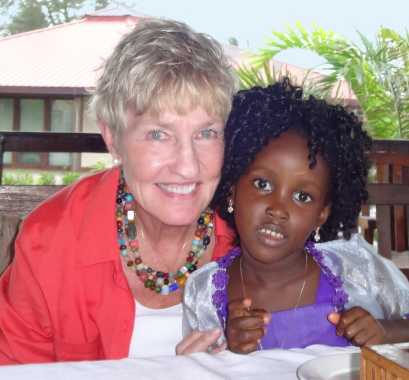 La Jolla resident and Foundation For Women Founder Deborah Lindholm with a 6-year-old girl also named Deborah, during a visit to Liberia in August 2014.