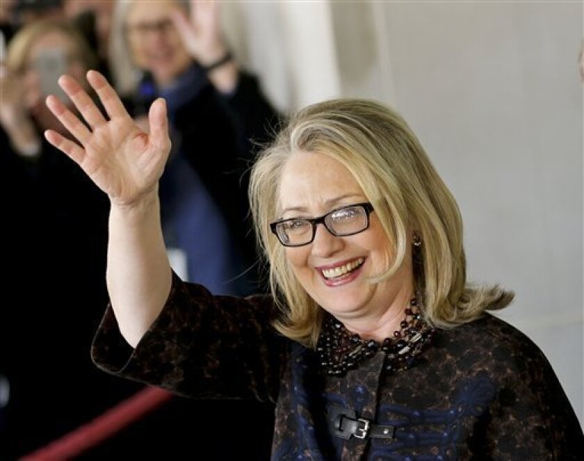 Outgoing Secretary of State Hillary Rodham Clinton waves as she leaves the State Department in Washington, Friday, Feb. 1, 2013, for last time as America's top diplomat. After four years, Clinton has traveled nearly one million miles to meet with leaders in over 100 countries. (AP Photo/J. Scott Applewhite)