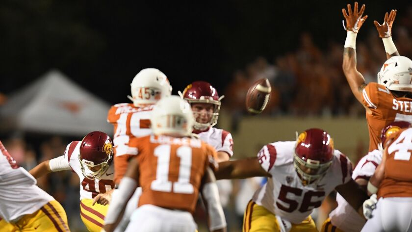 USC placekicker Chase McGrath has his field goal blocked by Texas in the third quarter at Royal-Texas Memorial Stadium on Saturday.