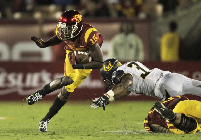 Trojans wide receiver Nelson Agholor eludes Cal cornerback Cedric Dozier in the first half.