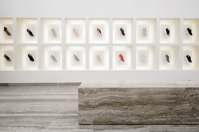 Taking inspiration from museum interiors, sneaker styles float are displayed in frame-like shelves at APL's first standalone bricks-and-mortar store, which opened the weekend before Thanksgiving at the Grove shopping center.