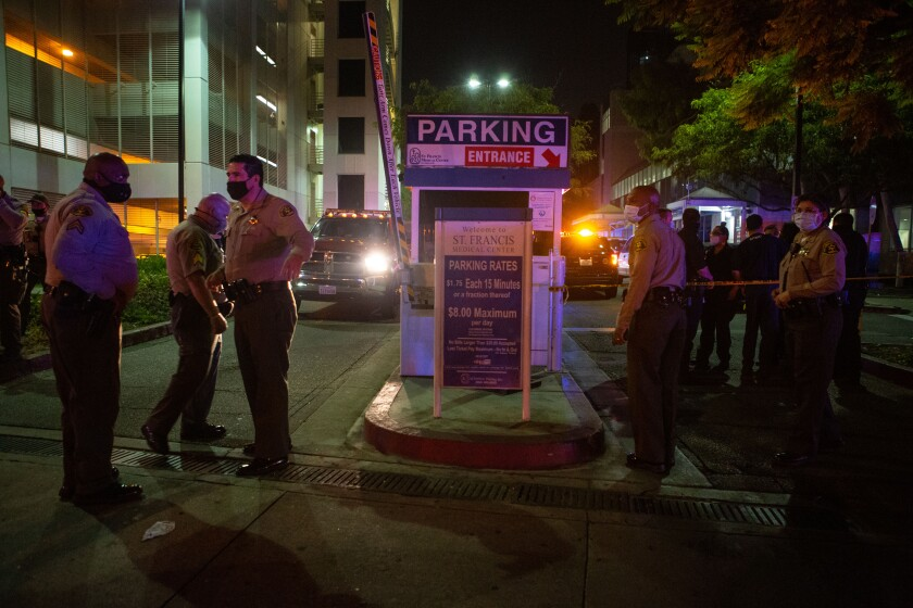 Sheriff's deputies outside St. Francis Medical Center on Saturday after the shooting of two colleagues.