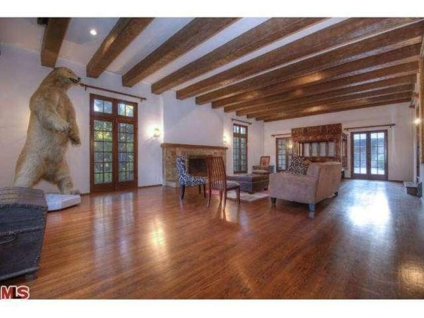 Rob Zombie's 1924 Tudor features extensive woodwork and beamed ceilings.