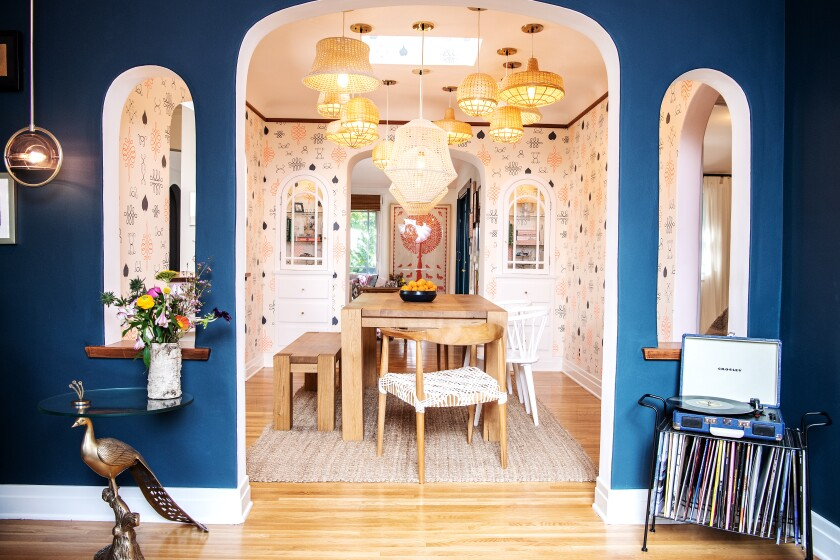 Arden Myrin installed multiple Ikea chandeliers in the dining room.