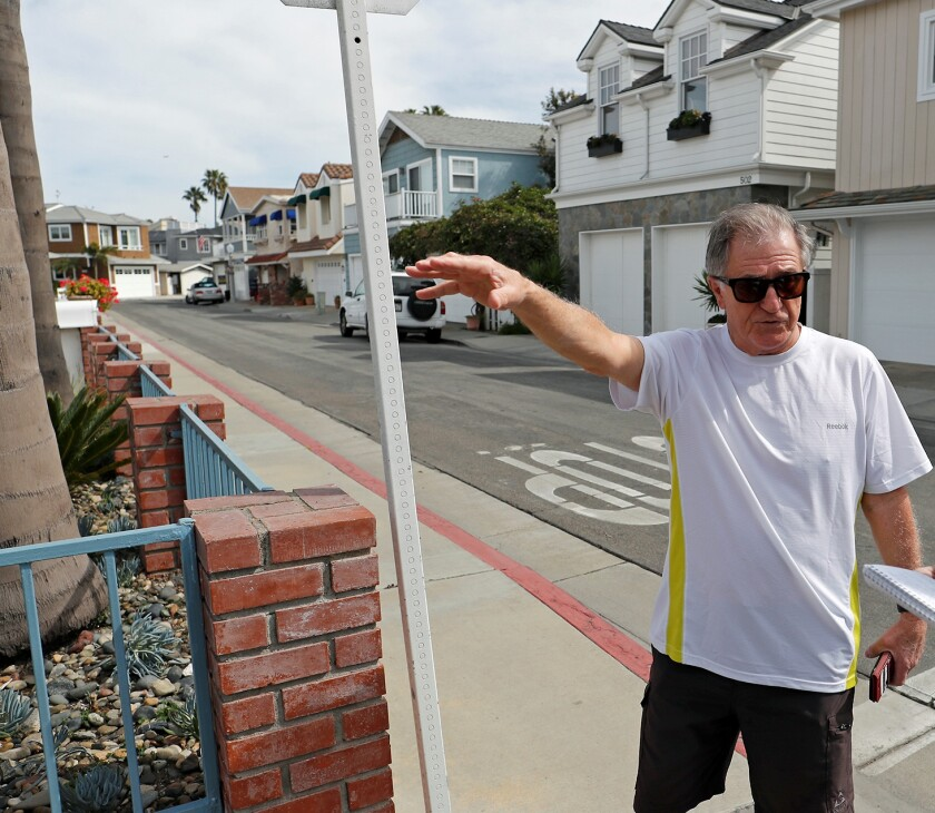 Newport Island resident Gary Cruz points out parking congestion.