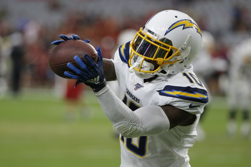 Artavis Scott catches his one pass in the Chargers' preseason opener at Arizona.