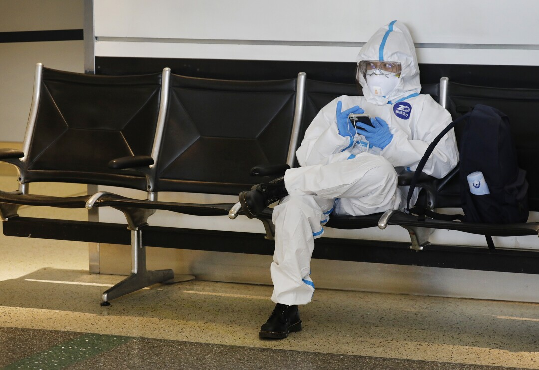 An air traveler waits to fly to China at the Tom Bradley International Terminal at Los Angeles International Airport.