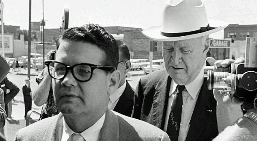 In this 1962 file photo, Billie Sol Estes, left, and his attorney, John Cofer, are shown arriving at the federal court house in El Paso.