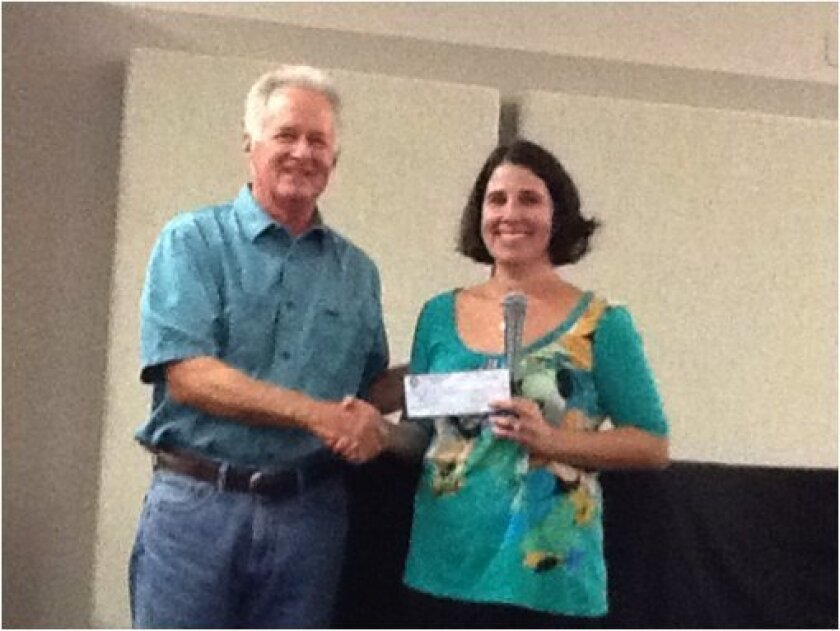 The Rotary Club of Del Mar recently presented a check to Casa de Amistad, Center for Learning. Nicole Mione-Green, director, is pictured with Bob Sonnhalter, chairman of Community services of the Rotary Club of Del Mar.
