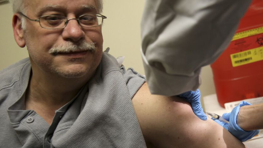 Steve Sierzega receives a measles, mumps and rubella vaccine at the Rockland County Health Departmen