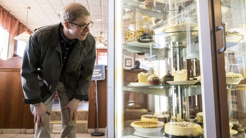 "Comedian Joe Pera, as choir teacher Joe Pera, examines a pastry case in the Adult Swim comedy ""Joe Pera Talks With You."""