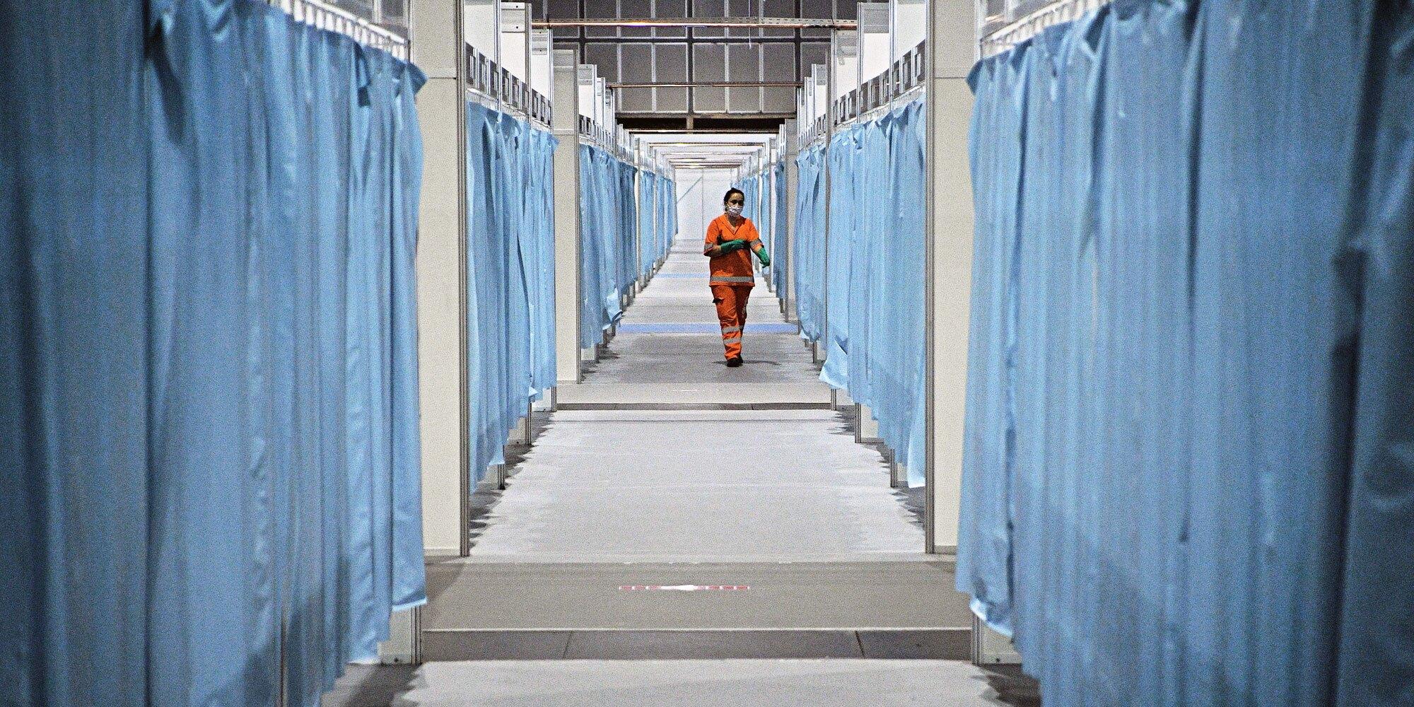 A cleaner walks through a corridor of a coronavirus field hospital in Rio de Janeiro.