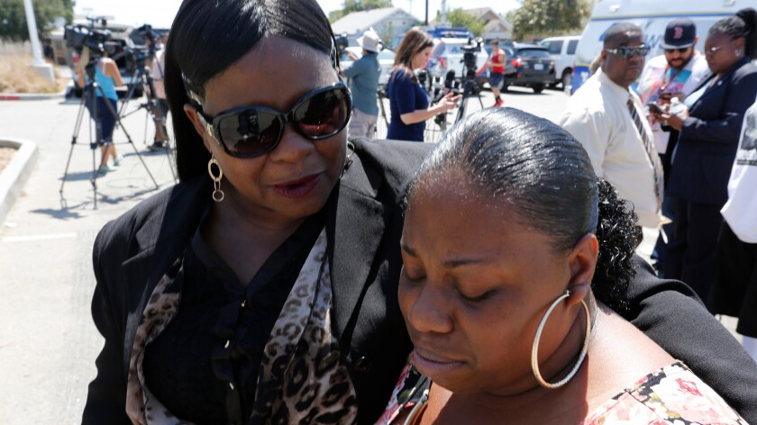 The mother of Clinton Alford Jr., Valerie Washington, and older sister, Lashaya Johnson, grow emotional Monday as they speak to reporters about the newly released video of Alford's 2014 arrest by the L.A. Police Department, which shows an officer kicking and punching the man.