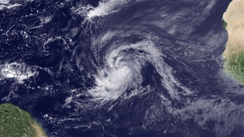 This satellite image provided by NOAA and taken Tuesday, Aug. 30, 2011, shows Tropical Storm Katia. Hurricane Katia is continuing its trek across the Atlantic Thursday, Sept. 1, 2011, with little change in strength. The U.S. National Hurricane Center in Miami says some strengthening is expected and Katia could become a major hurricane by the weekend.(AP Photo/NOAA)