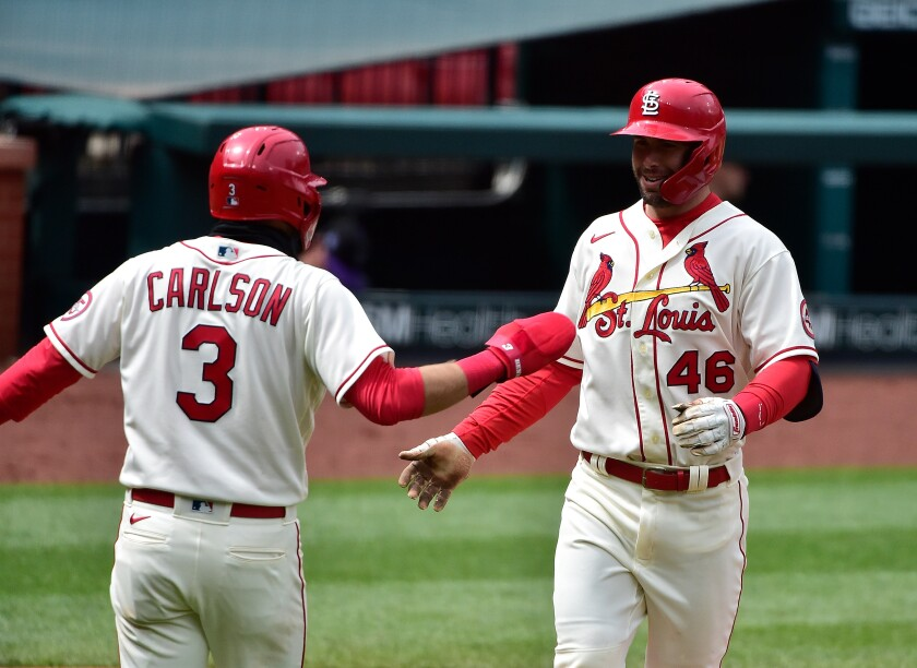 The Cardinals' Paul Goldschmidt celebrates with Dylan Carlson.