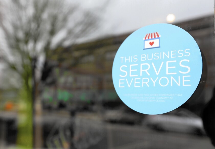 A window sticker on a downtown Indianapolis business on March 25 shows its objection to Indiana's religious freedom bill.