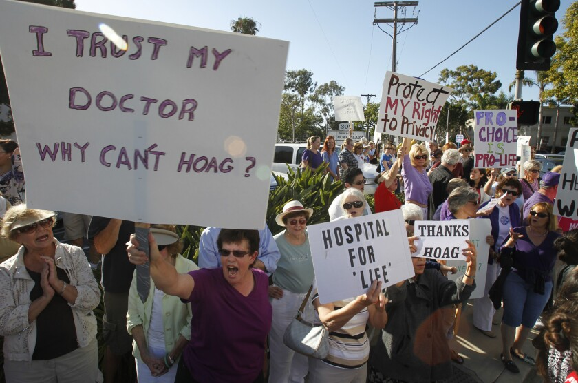 The shape of things to come? Demonstrators gather outside Hoag Hospital in Newport Beach on June 20, 2013, to protest a ban on abortions at Hoag after it partnered with a Catholic healthcare provider.