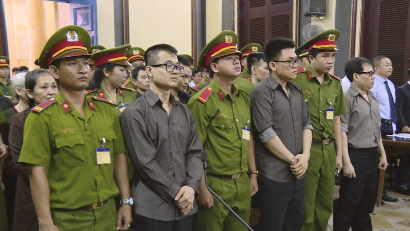 Members of the Provisional Central Government of Vietnam in exile in the United States stand trial i