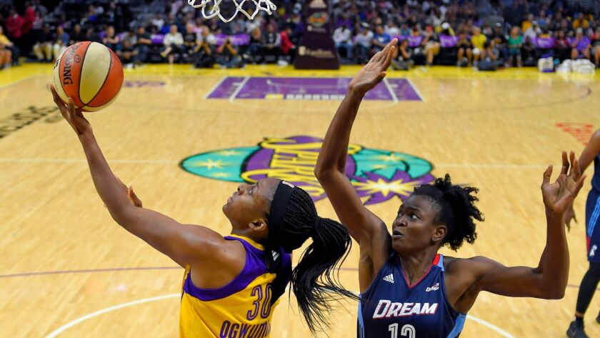 Sparks forward Nneka Ogwumike attempts a reverse layup against the defense of Dream forward Aneika Henry-Morello during the first half Friday.
