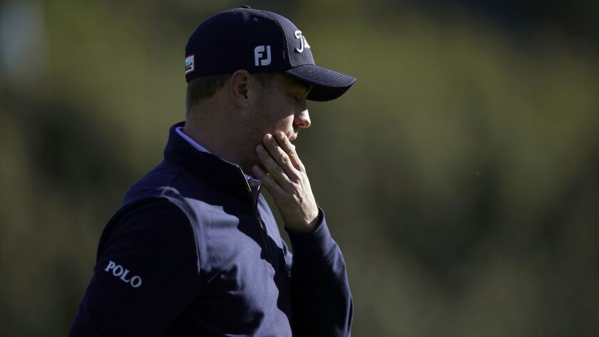Justin Thomas reacts after making double bogey on the 13th hole during the final round of the Genesi