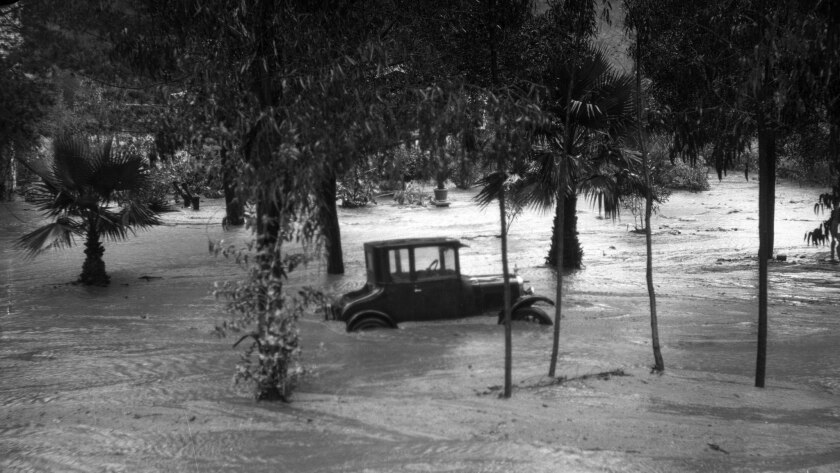 Feb. 1927: Automobile trapped in flood in Laurel Canyon, Los Angeles, 1927. Major flooding occured o