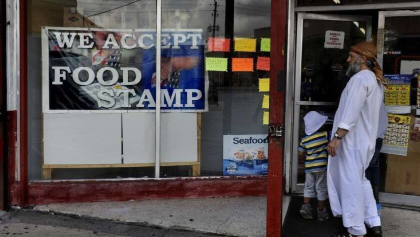 A store in Belle Glade, Fla, advertises that it accepts food stamps.