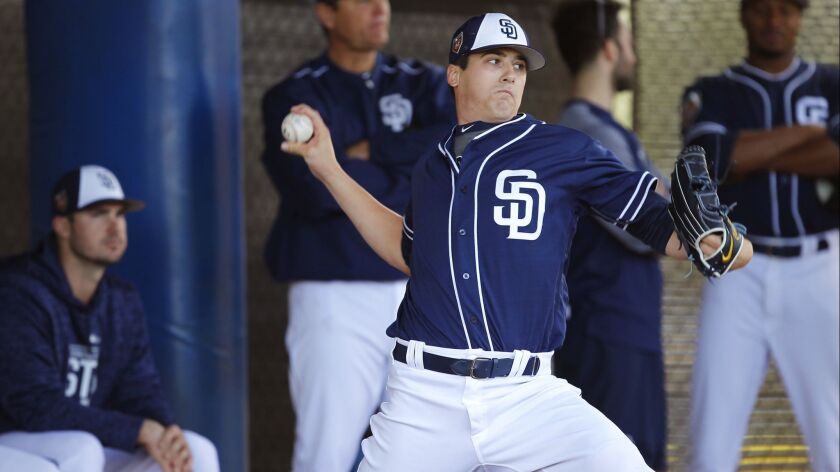 San Diego Padres pitcher Cal Quantrill throws during a spring training practice in Peoria on Feb. 19, 2018.