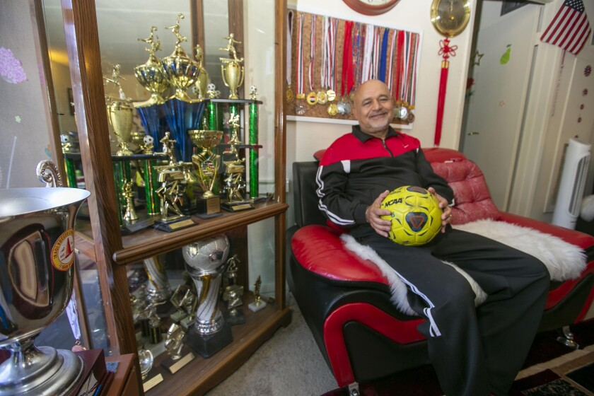 Salih Zayed, at his apartment in El Cajon on Dec. 17, 2019, came to the U.S. in 2012 from Iraq. He has created and coaches successful soccer teams for refugee youths.