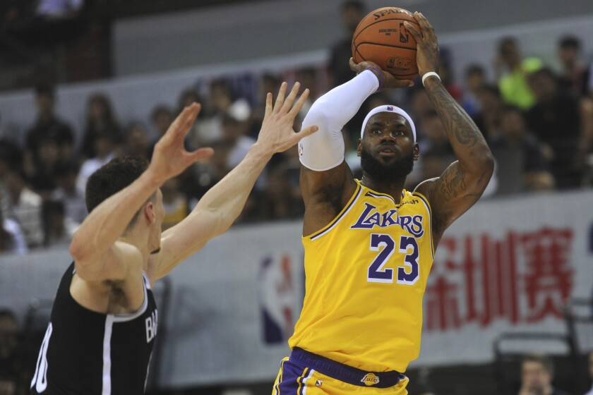 Los Angeles Lakers' LeBron James in action during a match against Brooklyn Nets at the NBA China Games 2019 in Shenzhen in south China's Guangdong province on Saturday, Oct. 12, 2019 (Color China Photo via AP)