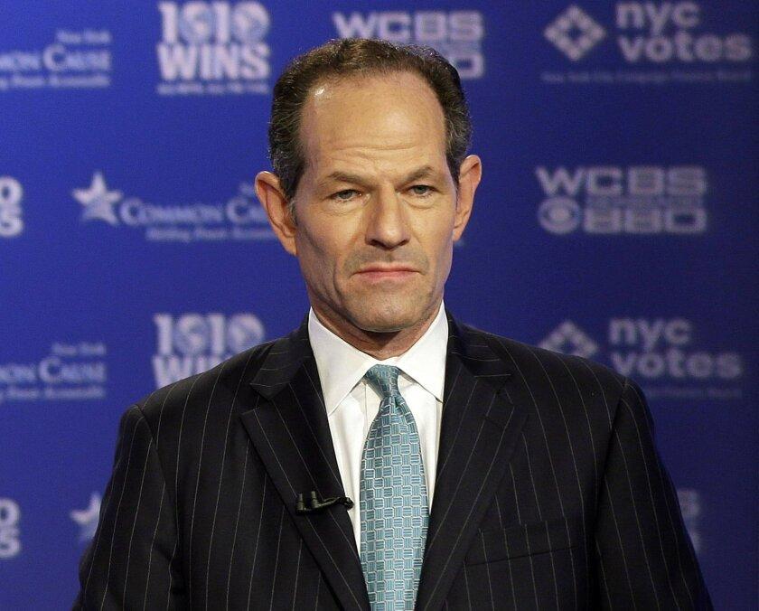 FILE - In this Aug. 22, 2013 file photo, former New York Gov. Eliot Spitzer participates in a primary debate for New York City comptroller in the WCBS-TV studios, in New York. Police are investigating a woman's report that she was assaulted by former New York Gov. Eliot Spitzer at The Plaza Hotel.