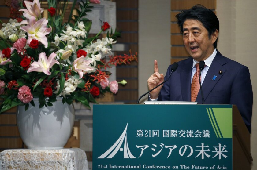 "Japanese Prime Minister Shinzo Abe speaks during a banquet of a symposium on the ""Future of Asia"" in Tokyo, Thursday, May 21, 2015. Vying to keep pace with China's rising influence and economic clout, Japan plans to provide $110 billion to help develop roads, ports and other infrastructure in Asia in the next five years, Prime Minister Abe said Thursday. (AP Photo/Shizuo Kambayashi)"