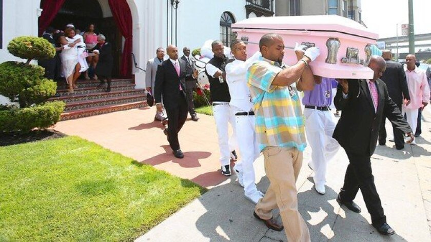 Pallbearers carry the casket of Alaysha Carradine, 8, who was shot to death at a slumber party in Oakland in July. A 7-year-old girl and a 4-year-old boy were wounded. Last year, 12 children were among the city's 130 homicides — 90% of them gun-related.