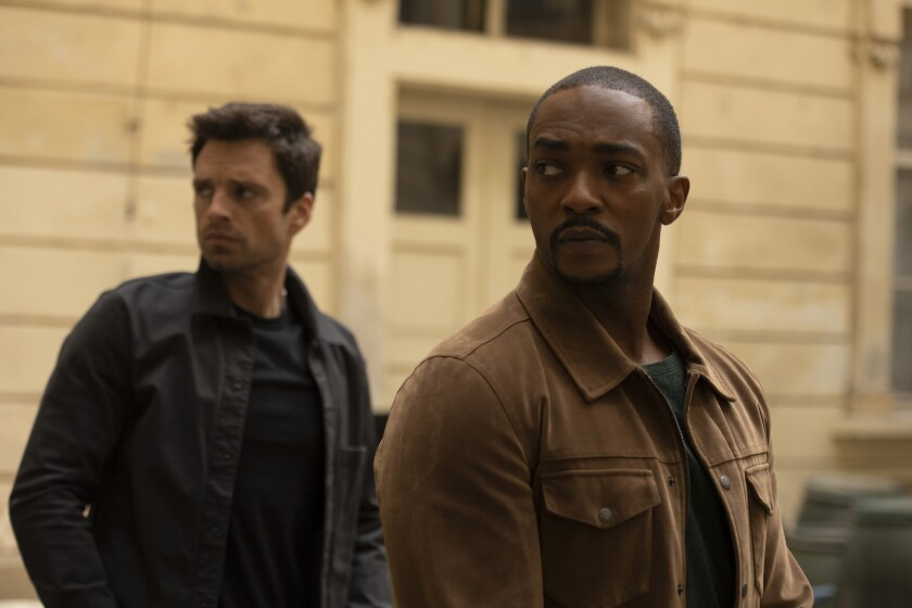 Sebastian Stan and Anthony Mackie looking away