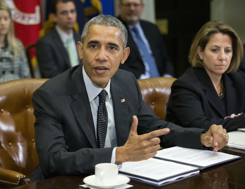 President Barack Obama meets with members of this national security team and cybersecurity advisers in the Roosevelt Room of the White House in Washington,Tuesday, Feb. 9, 2016. At right is Lisa Monaco, assistant to the president for Homeland Security and Counterterrorism. (AP Photo/Pablo Martinez
