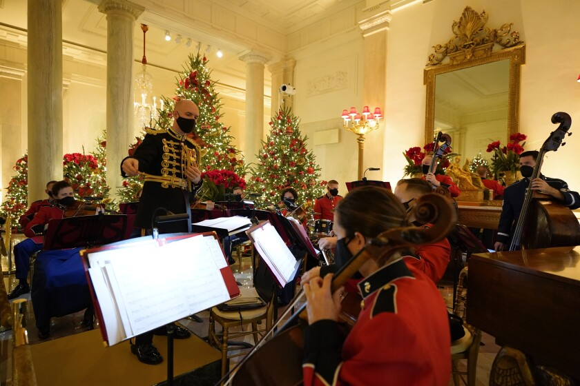 A U.S. Marine Corps band performs in the Entrance Hall of the White House during the 2020 Christmas preview, Monday, Nov. 30, 2020, in Washington. (AP Photo/Patrick Semansky)