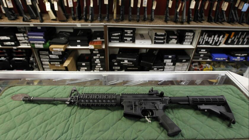 An AR-15 style rifle is displayed at the Firing-Line Indoor Range and Gun Shop in Aurora, Colo. on July 26, 2012.