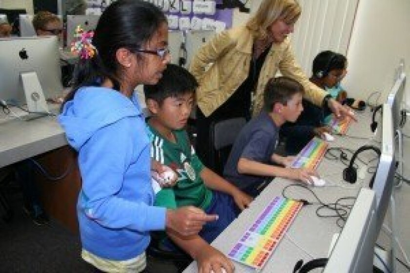 Susie Hopper's fifth grade class at Torrey Hills School participates in Hour of Code, learning computer programming.