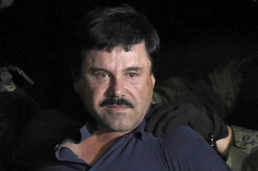 "This file photo taken on January 08, 2016, shows drug kingpin Joaquin ""El Chapo"" Guzman escorted into a helicopter at Mexico City's airport following his recapture during an intense military operation in Los Mochis, in Sinaloa State."
