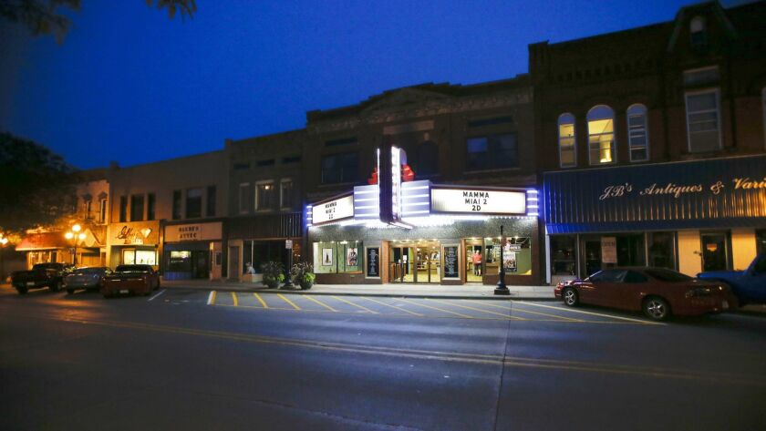 """WEBSTER CITY, IA, AUGUST 18, 2018: The marquee is lit up for the seven o'clock showing of """"Mamma Mia"""