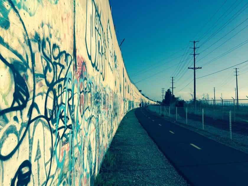 Graffiti along a retaining wall heading south on a portion of the Bayshore Bikeway in Chula Vista
