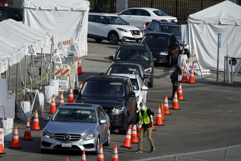 Motorists line up to take a COVID-19 test Tuesday, Jan. 5, 2021, in Los Angeles. (AP Photo/Marcio Jose Sanchez)