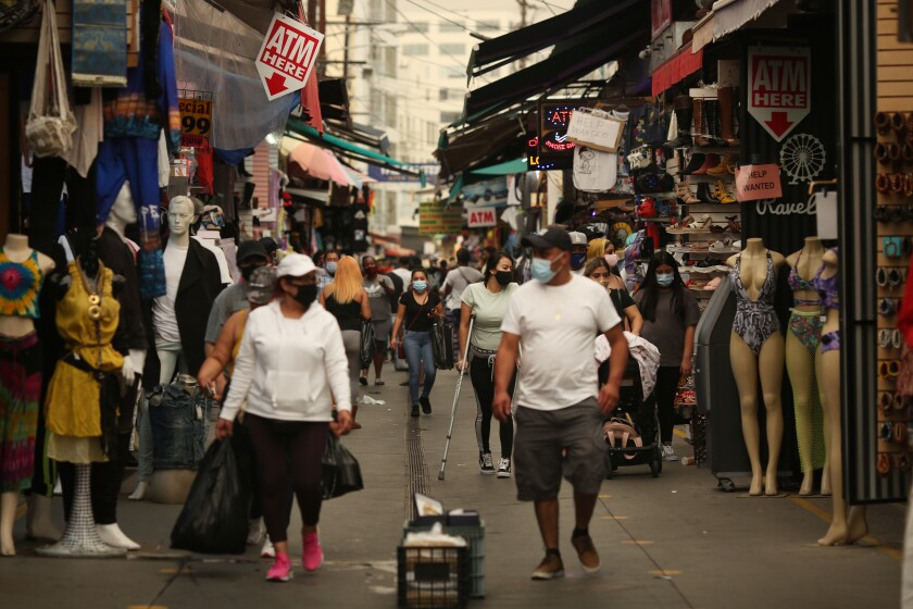 People walk along Santee Alley in downtown Los Angeles