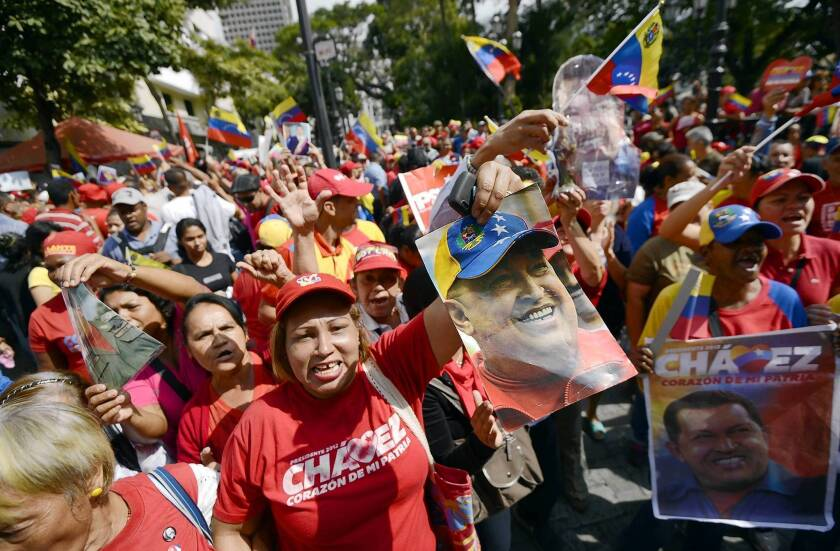 Supporters of Venezuelan President Hugo Chavez gather at Simon Bolivar Square in Caracas to celebrate his return after cancer surgery in Cuba.